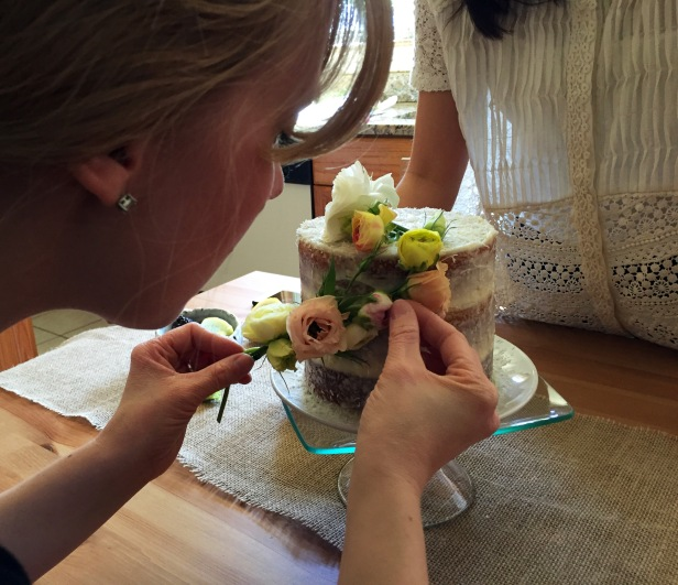 Wrapping the braid of blooms down the side of cake - it's harder than it looks!